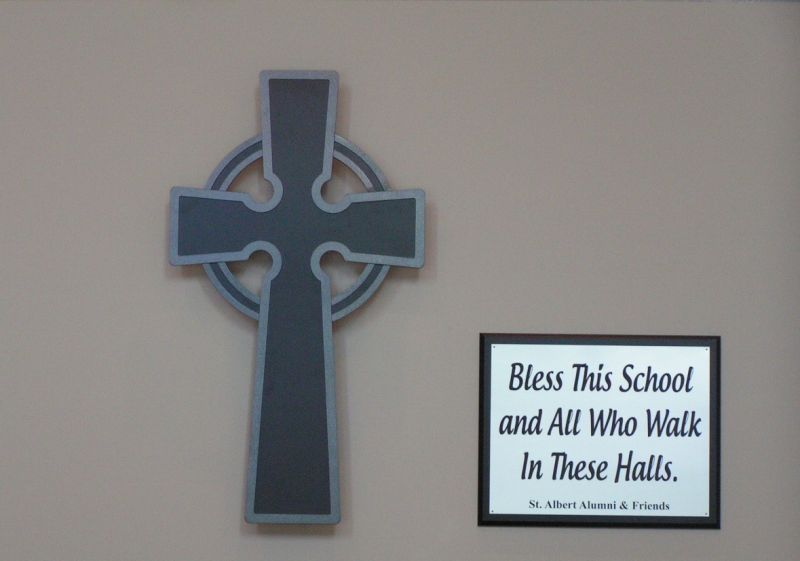 St. Albert Alumni & Friends Cross & Plaque at the entrance to the Primary School